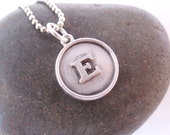 Rimmed sterling silver raised initial disc necklace