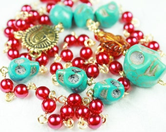 Muertos Skull Rosary with Flaming Turquoise Stone Skull and Red Glass Pearls in Gold