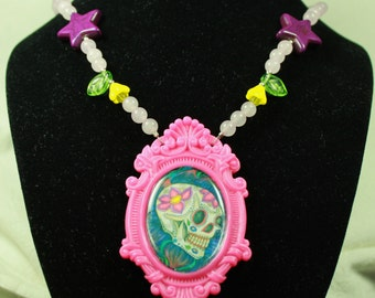 Sugar Skull Art Necklace in Pink with Rose Quartz, Purple Stars and Glass Flowers
