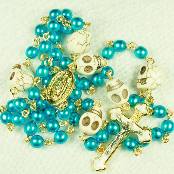 Muertos Skull Rosary in Gold with Turquoise Blue Glass Pearls and bone White Stone Skulls