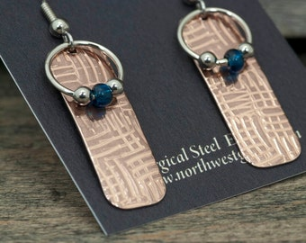Dangly copper patterned  earrings with blue and silver beads
