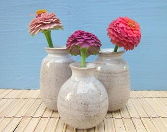 3 small white bud vases