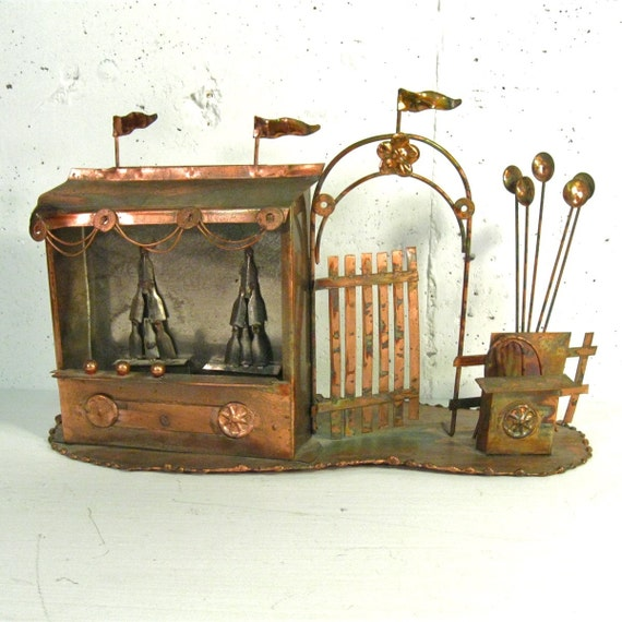 Vintage copper sculpture of county fair or carnival booth