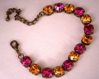 Awesome  Swarovski crystal pink fuchsia and orange topaz 8mm tennis style bracelet.antique bronze setting,lovely colour combination