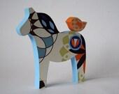 blue horse with orange bird