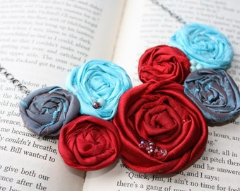 Bridesmaid bib necklace, Rosette necklace, fabric flower statement necklace,  Red Aqua Turquoise and Teal rolled satin rosettes