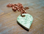 there is a road to buried dreams -- porcelain poem pendant