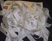 10 yards of Oatmeal Seam Binding wrapped on a blank manila shipping tag