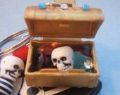 SALE----The Pirates Booty Keychain---- pirate flag skull beads and a treasure chest of jewels
