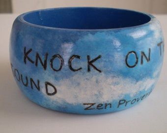 Knock On The Sky...  Burned and Painted Wood Bangle