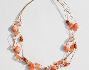4 Strand Necklace in Creamy Corals