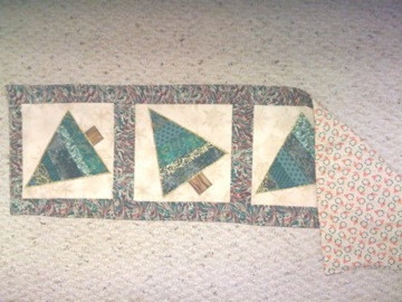 Table runner accented with Four Tipsy Trees