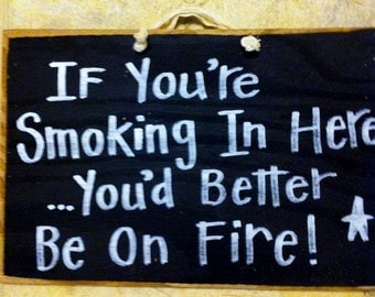 If You're smoking in here you'd better be on FIRE sign