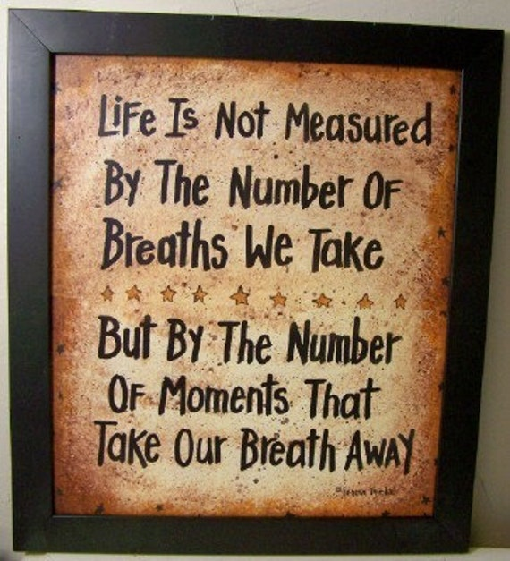 Life not measured by breaths we take but moments that take breath away sign framed 15 X 17