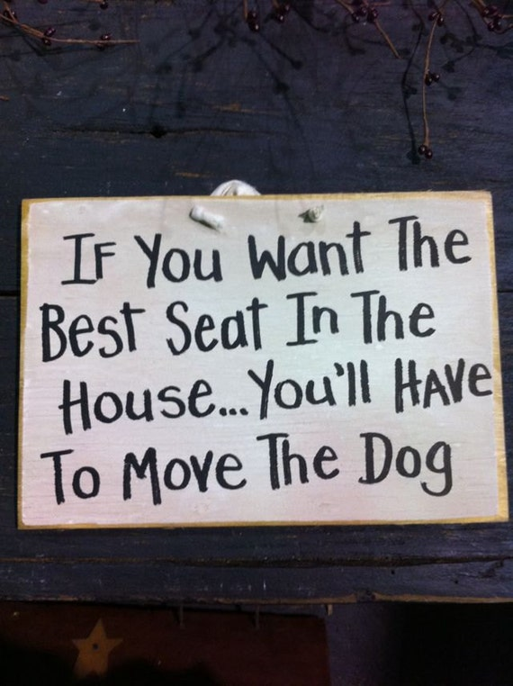 If you want the best seat in the house you'll have to move the DOG wood sign
