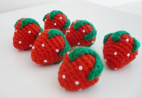 Set of 6 hand crocheted strawberries.