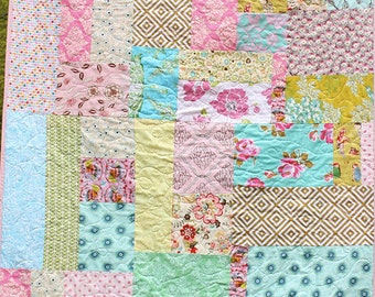 Custom Quilt 50 x 70 Inches.  You choose general color theme.