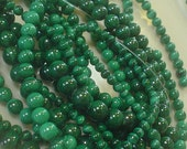 malachite. green. smooth round. 4mm/30 beads. grade a