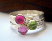 Peridot, rose pink sapphire and ruby stacking ring set