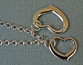 The Same but Separate. Mother's Day Bracelet. Silver plated hearts.