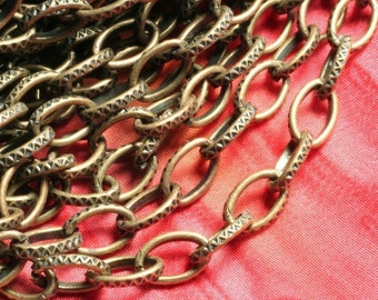 5 FT Antique brass large textured cross chain link size 7x5mm (item ID YWAB1.2BSOK)