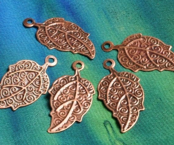 Antique copper leaf charm 21x12mm, pk 12 (item ID ACLC21x12)