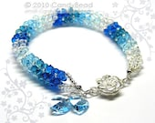 Swarovski Crystal Bracelet, Luxurious Blue Shade Swarovski Crystals with Floral Magnetic clasp by CandyBead