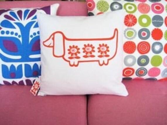 Scandinavian style screen printed sausage dog cushion cover