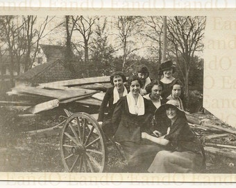 Antique Photo, Snapshot Group of Friends, Seven 7 women Sitting on a Wagon with Building Materials in the Background