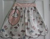 vintage pink apron with black rickrack