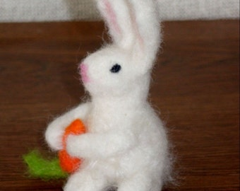 Felted Bunny holding a carrot