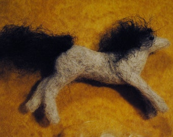 Running horse pin or ornament.