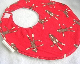 Sock Monkeys on Red - Boutique Bib - terry cloth backing with snag free velcro closure
