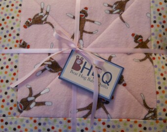 Pink Flannel Sock Monkey Baby Girl Quilt in Cotton-Flannel. Nursery Baby Cradle Bedding, Crib Blanket, or Toddler Bed