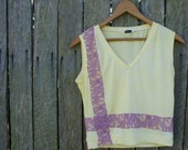 Lemon-yellow slim fit tee with rose pink lace accents. Small - Medium.