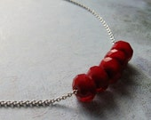 Red Crystals in a Row on Rhodium Chain