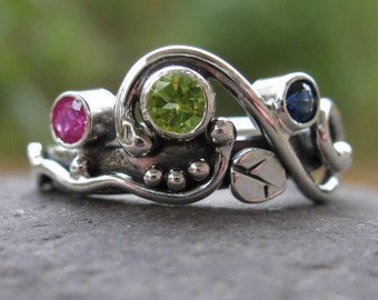 unique multi stone mothers ring . family ring . sterling silver & 3 birthstones .( Wild Garden Mother's Ring ). customized and made to order