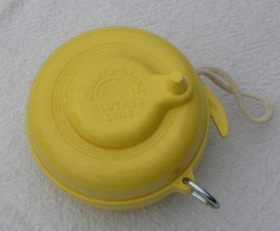 Vintage Yellow Lustro Ware Plastic Retractable Clothesline