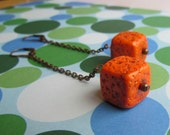 November Dangle Orange Earrings. Long dangle orange cube earrings.