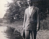 vintage photo Young Man Poses w His Hat Down by the edge of the Lake