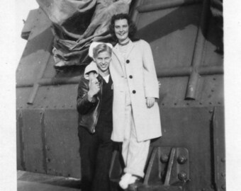 Sailor Guy and His Gal on board ship with machine gun vintage photo
