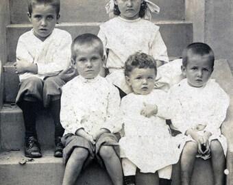 Sweet Children Sit on Steps 1905