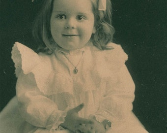 Little Girl Bow and white Dress 1909