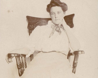 vintage photo Pensive young lady in Chair