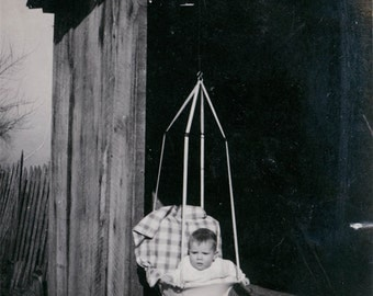 vintage photo Baby Mildred in 1911 Bouncy Toy in Barn