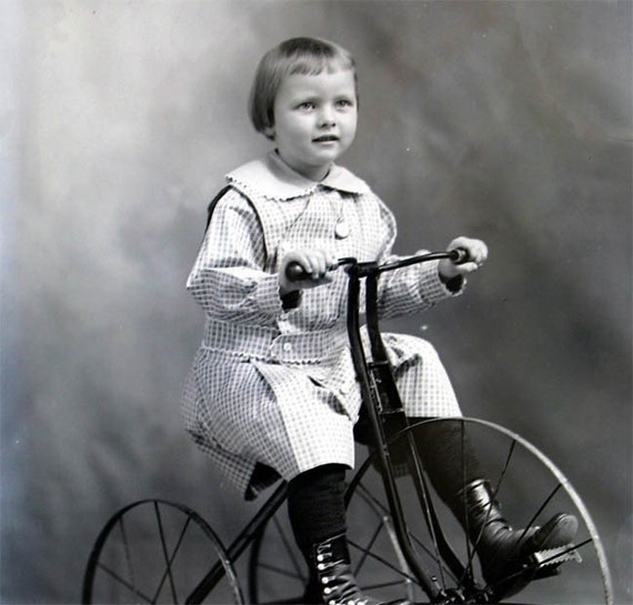 Vintage photo print Little Girl Rides Old Fashioned Tricycle fine art photograph