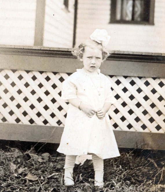 vintage photo Little Girl Jessie Curled Hair Bow in Yard RPPC
