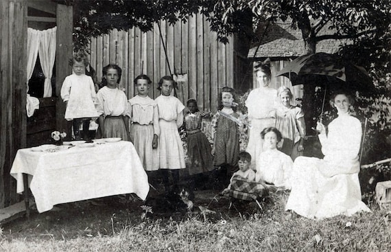 Back Yard Party w Little Girls and dog  lined up one scratched out Face Summer vintage photo postcard