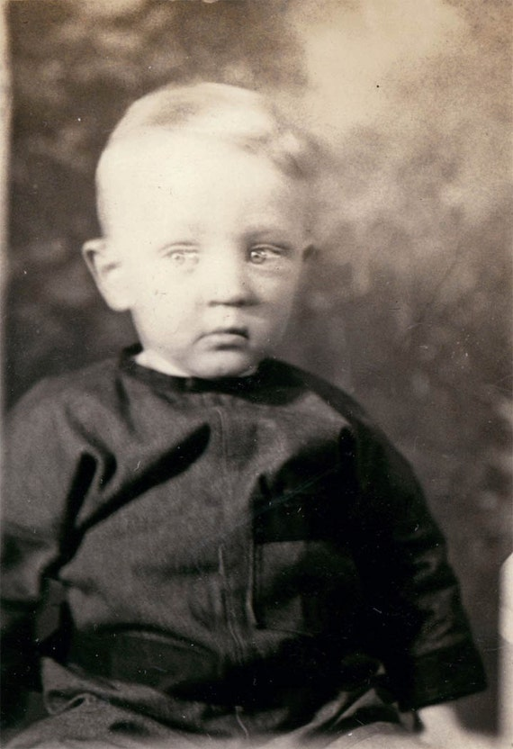 vintage photo Sweet little baby What does he see unusual