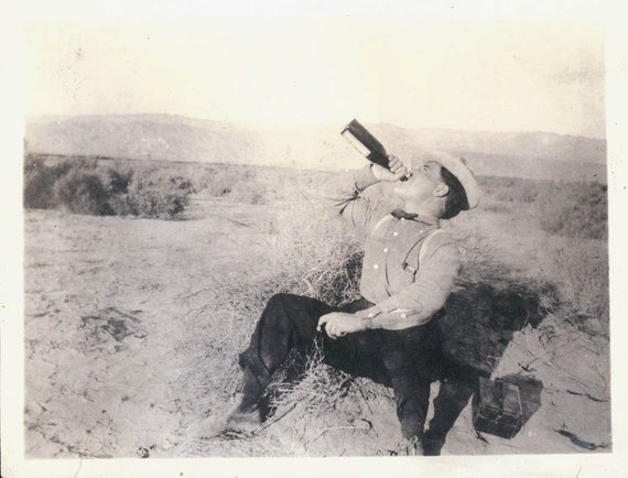 Vintage photo Bow Tie Cowboy Drinking in the Desert